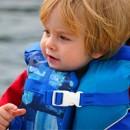 Toddler in lifejacket on boat