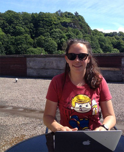 Bridget working on the office roof on a beautiful summer day!